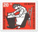 Stamp: Mutter mit Kind in einer Wiege