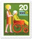 Stamp: Pflegehilfe: Frau im Rollstuhl