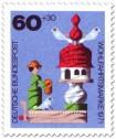 Stamp: Holzspielzeug: Frau am Taubenhaus