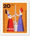 Stamp: Holzspielzeug: Frauen am Butterfass