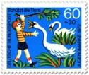 Stamp: Junge ärgert Schwäne am See