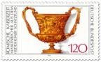 Stamp: Goldener Becher mit Masken (römisch)