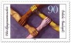 Stamp: Hände greifen Arme - Entwicklungszusammenarbeit